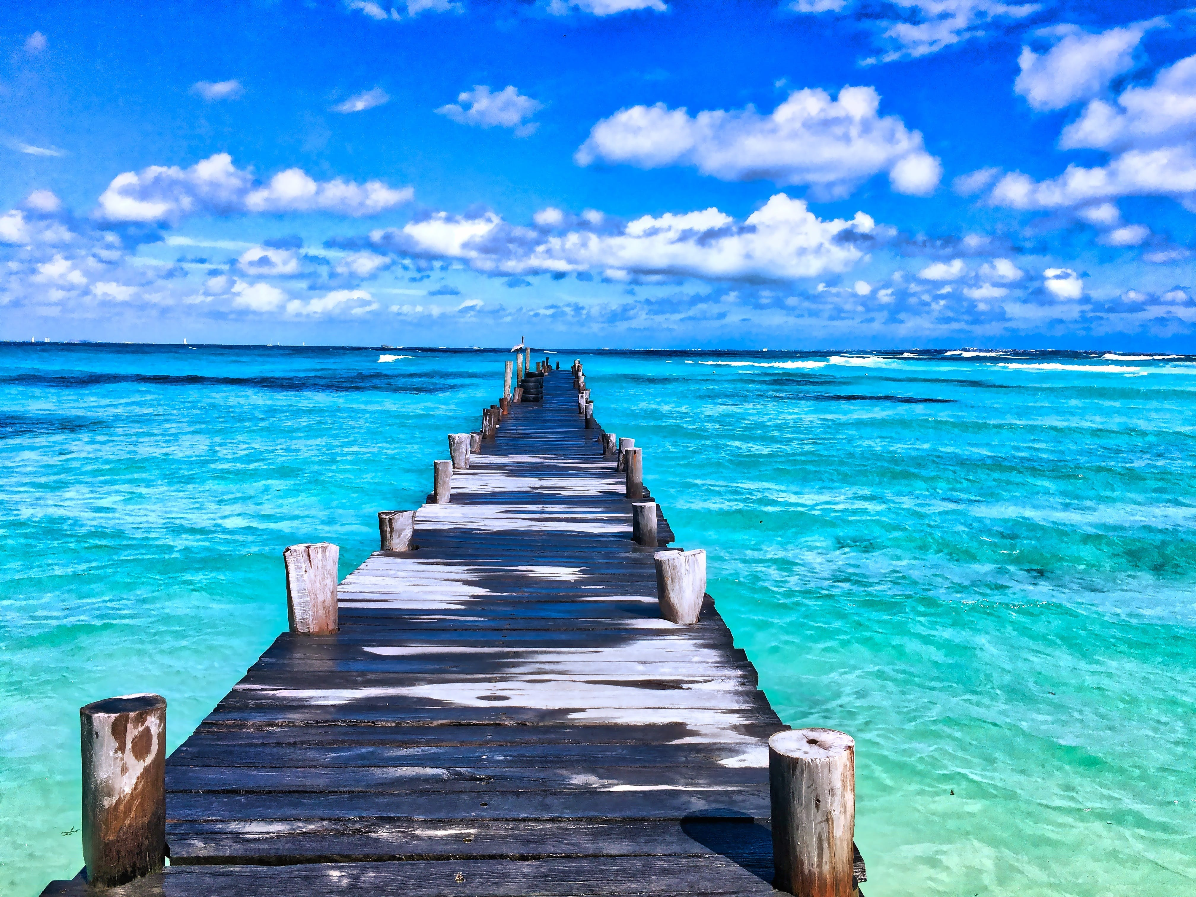 Brown Wooden Dock Across Clear Ocean