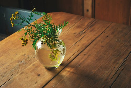 Vase with wild flowers on table