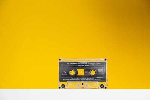 Transparent Cassette Tape On Yellow Background
