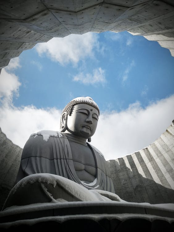 Low Angle Photography of White Concrete Statue Under Blue Sky