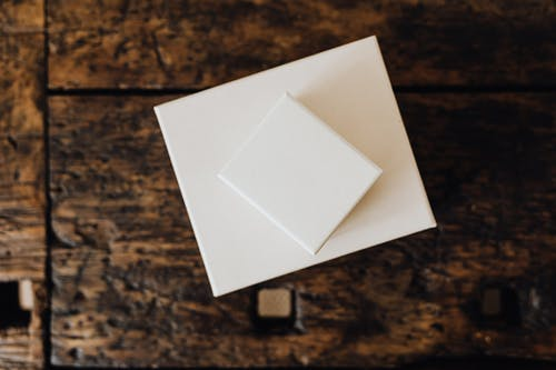 Stack of white carton boxes on wooden table