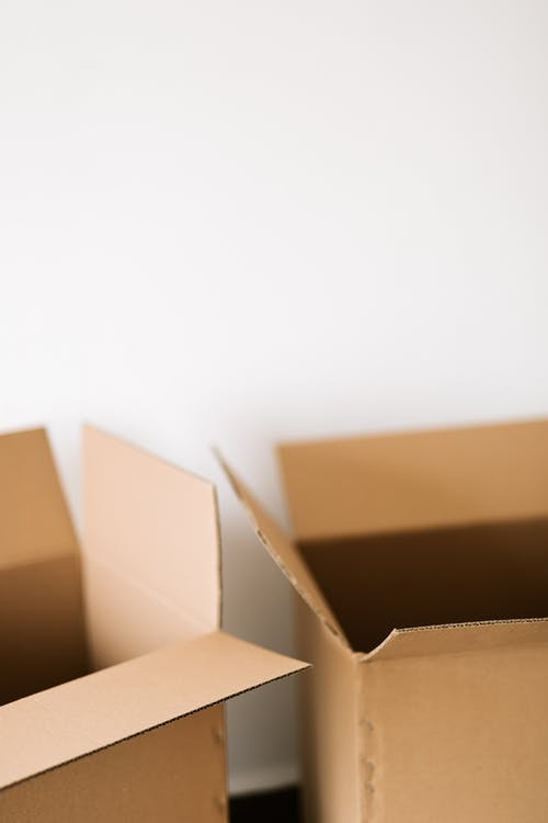 Cardboard boxes against white plain wall