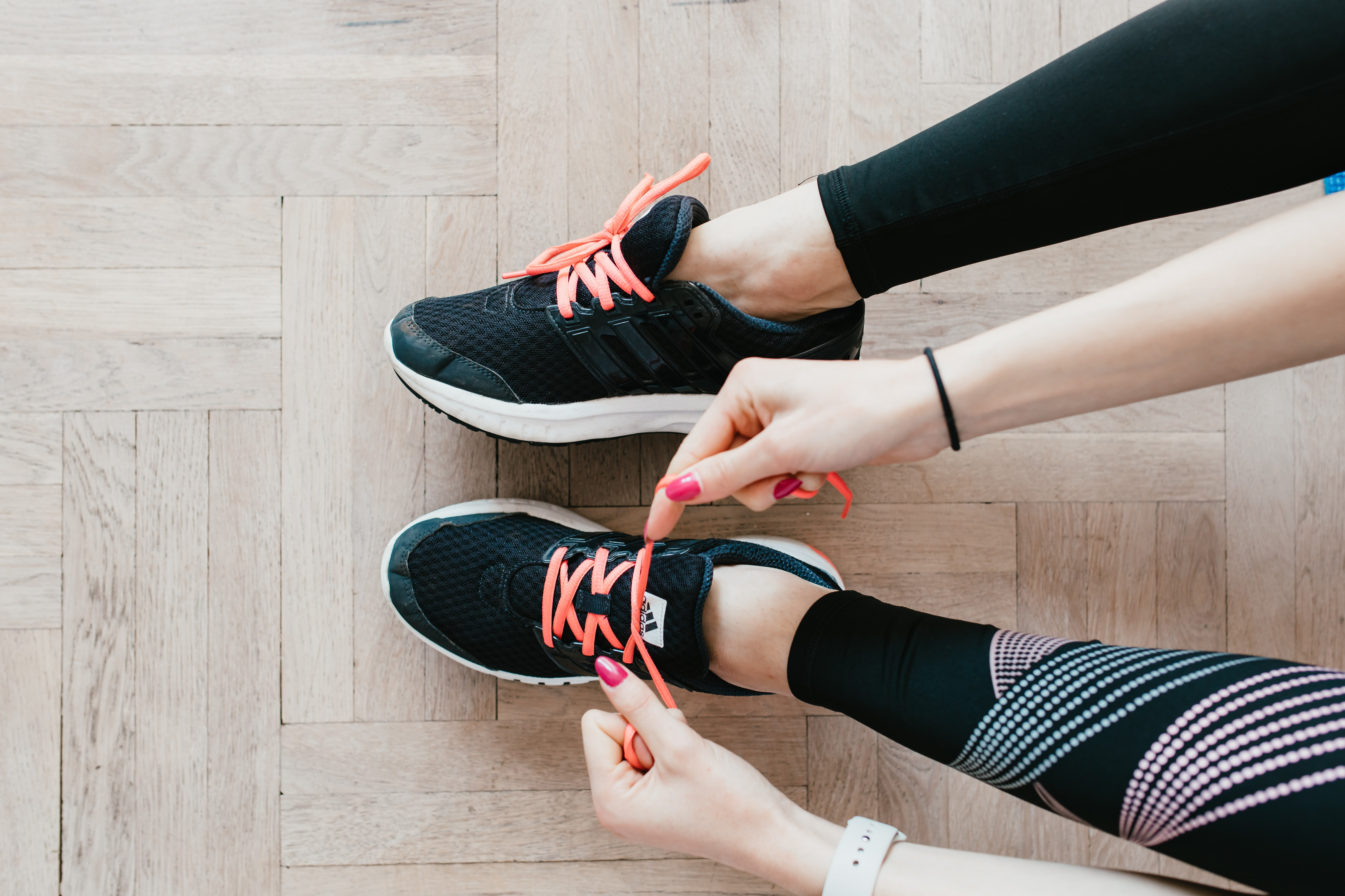 fast weight loss exercise at home - young-sportswoman-tying-sneakers-on-floor