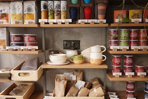 White Ceramic Bowl on Brown Wooden Shelf