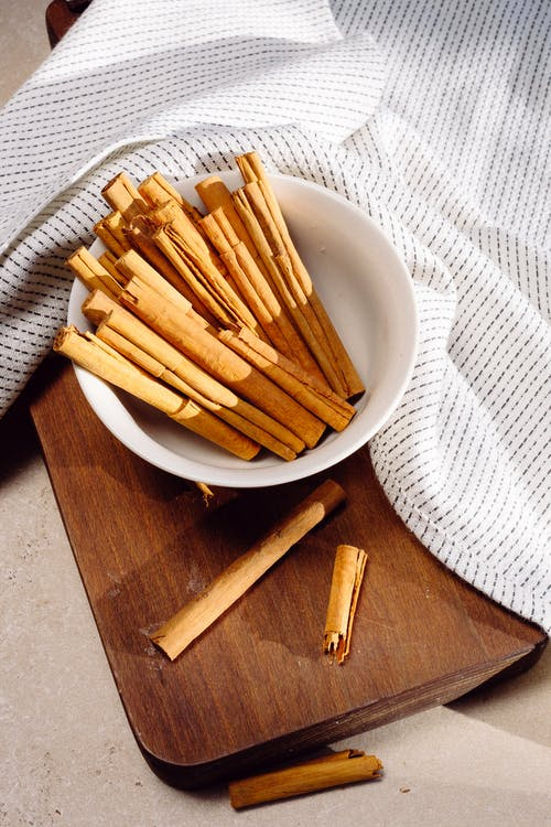 Brown Wooden Sticks on White Ceramic Bowl