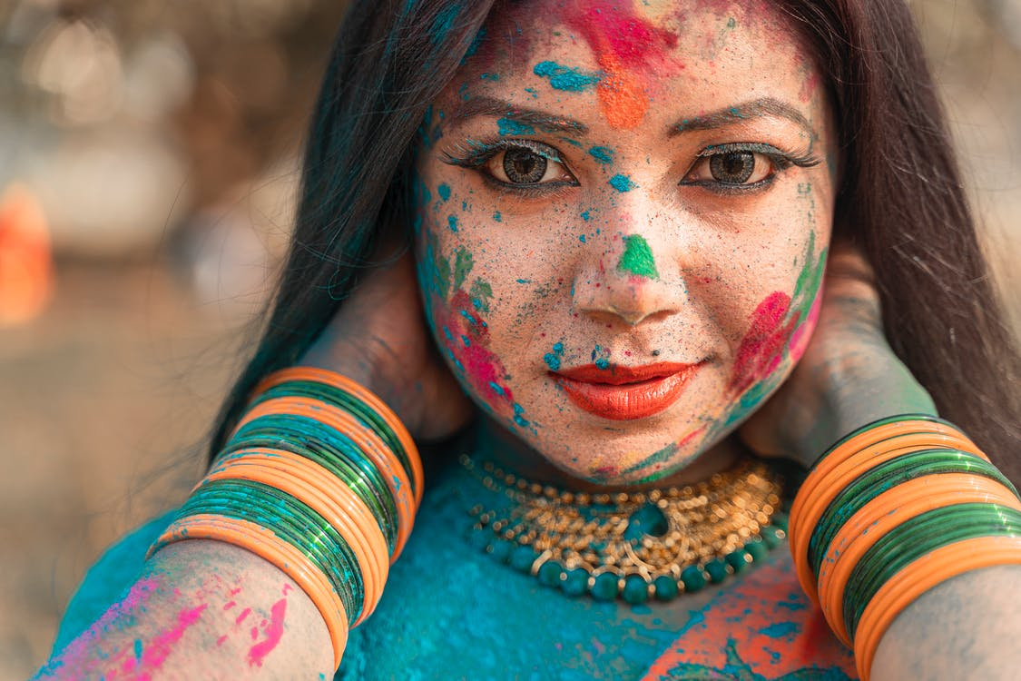 Woman With Red and Blue Face Paint