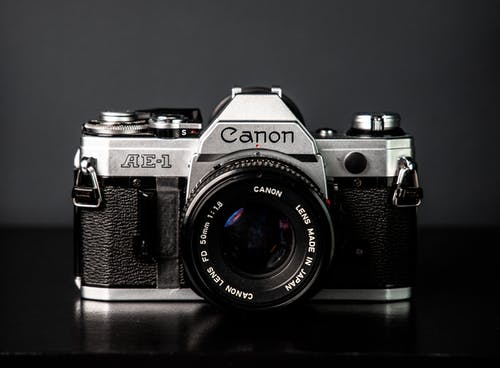 Retro camera on gray background