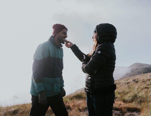 Man in Black Jacket Kissing Woman in Black Jacket