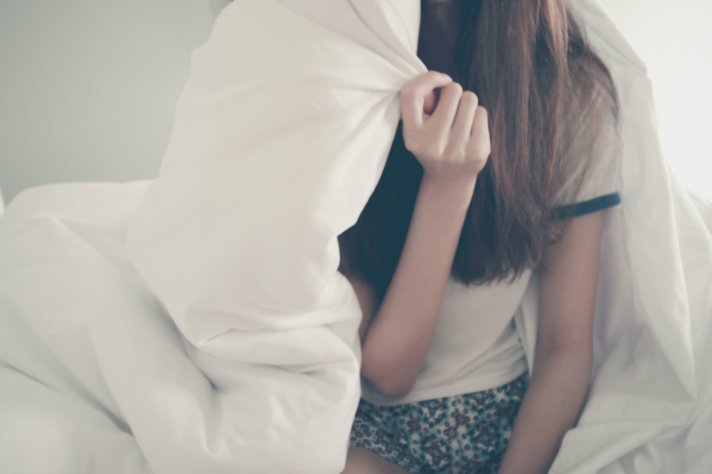 Woman Under Comforter