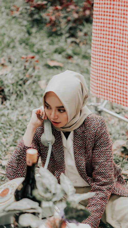 Photo of Woman in Beige Hijab