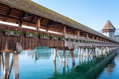 Old Chapel Bridge over river in Lucerne