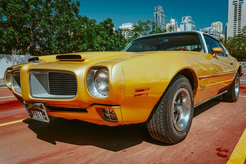Yellow Pontiac Car