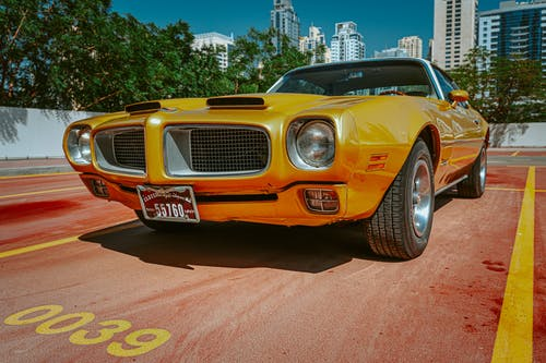 Photo of Yellow Pontiac Car