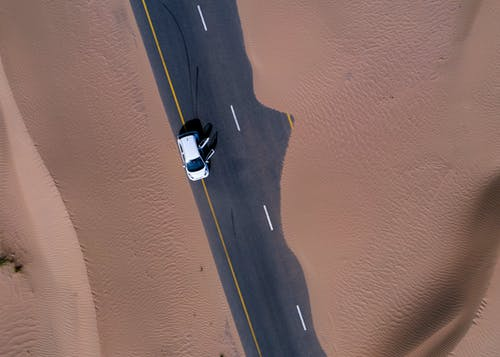 Aerial View of White Car on Road