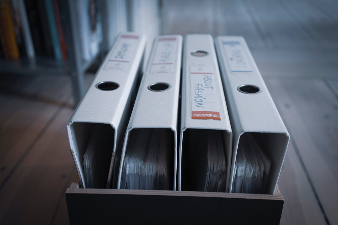 Collection of ring binders in box at home