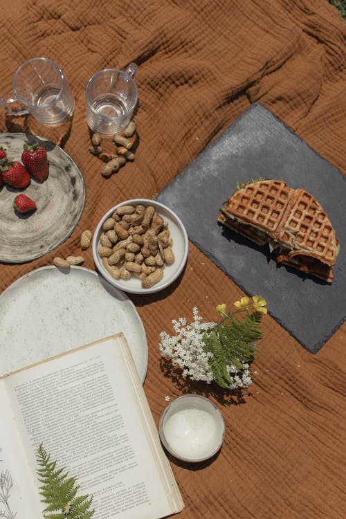 Waffle With Sliced Strawberries and Cream on White Ceramic Plate