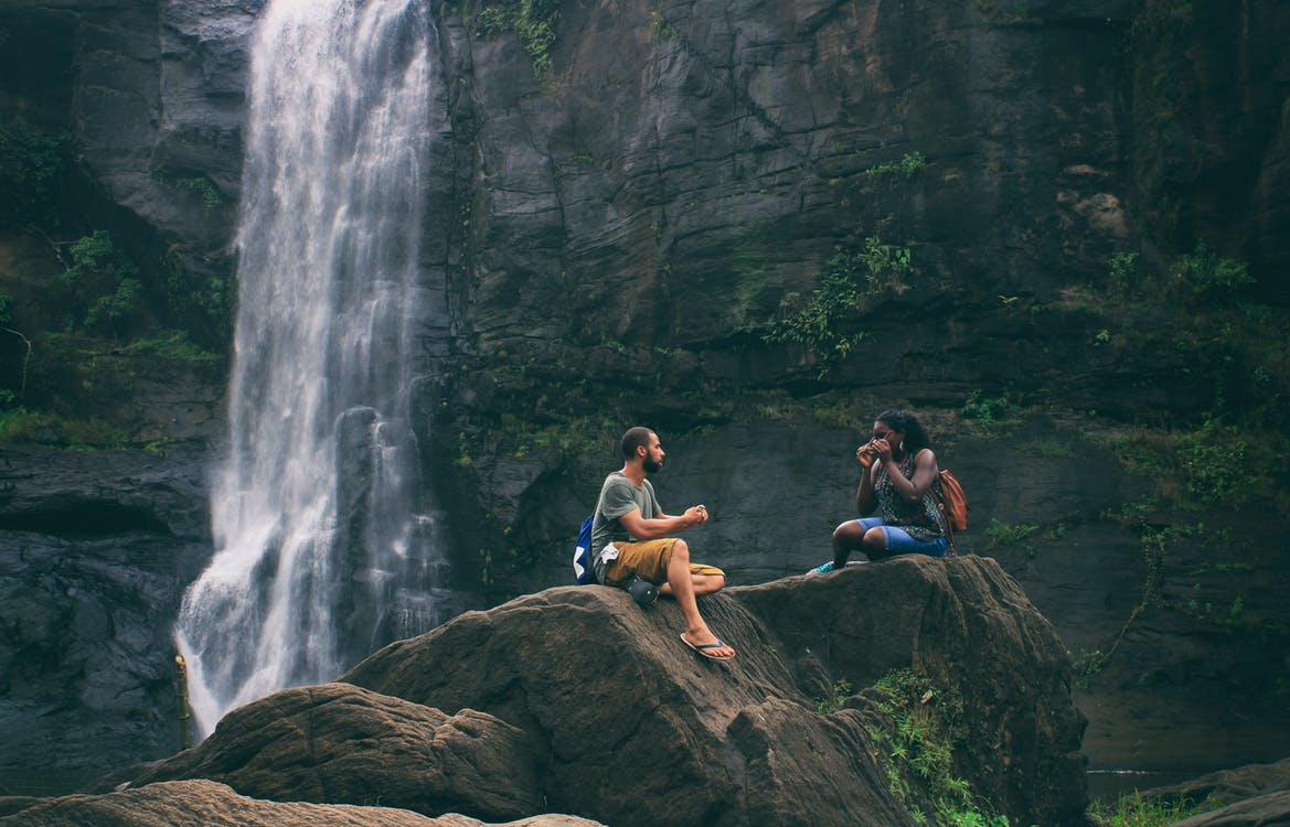 Man and Woman Near Waterfall