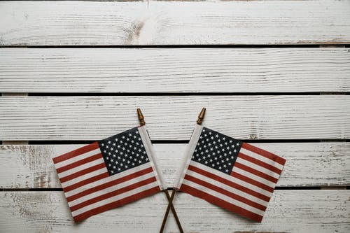 USA flags on sticks on wooden table