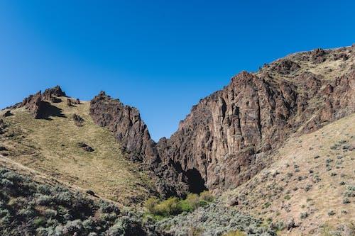Kostnadsfri bild av äventyr, berg, brant, dal