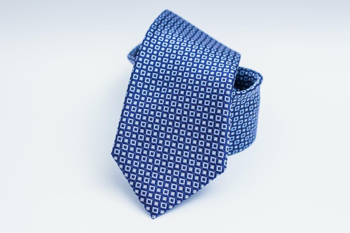 Blue Necktie on White Surface