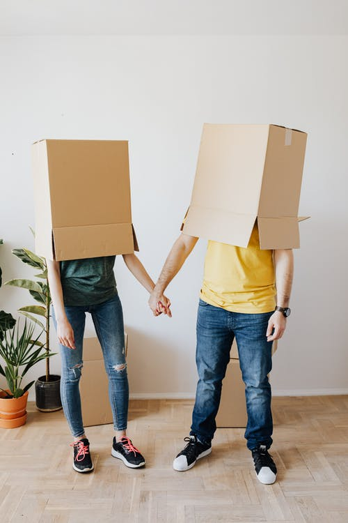 Funny couple with carton boxes on heads
