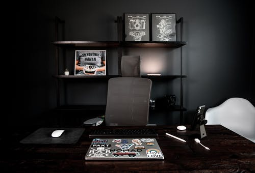 Interior of modern workplace with laptop on table