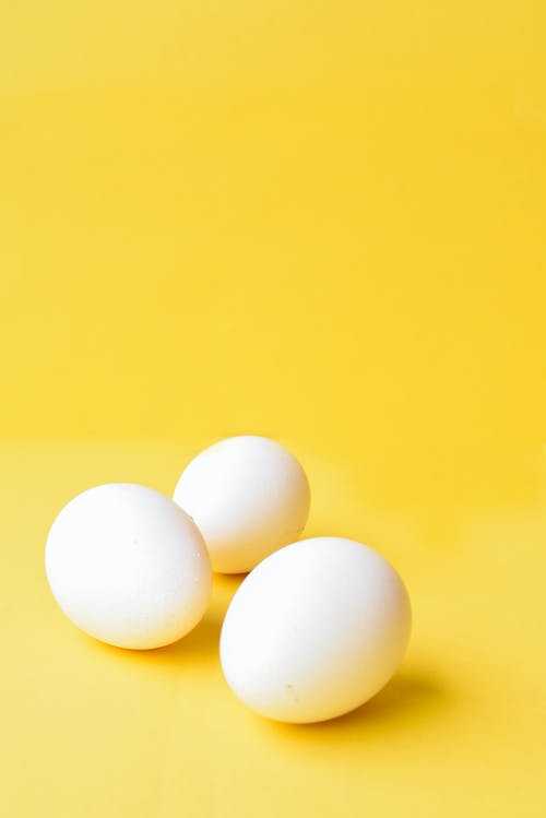 White Eggs on Yellow Background