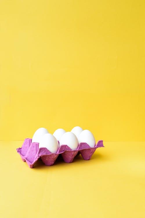 Egg Carton on Yellow Background