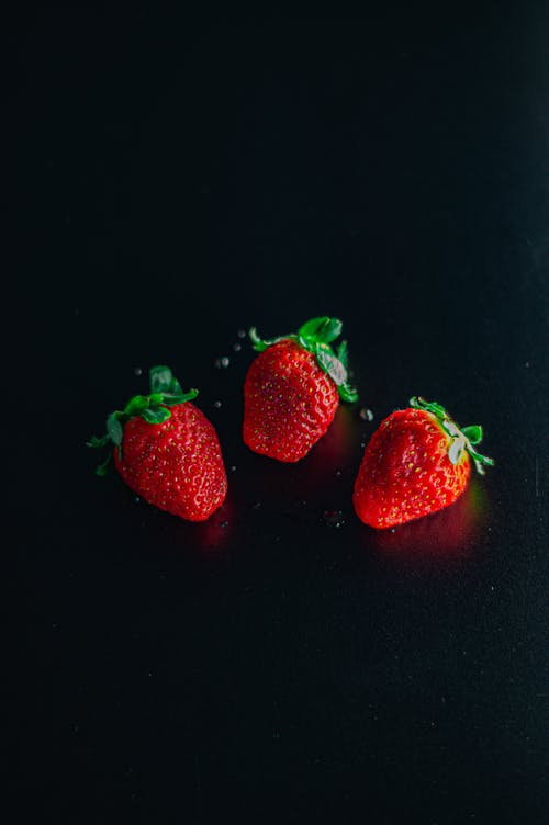 Ripe strawberries placed on black table