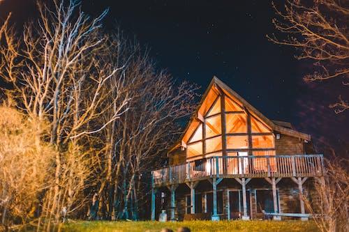 Contemporary cottage with big veranda at night