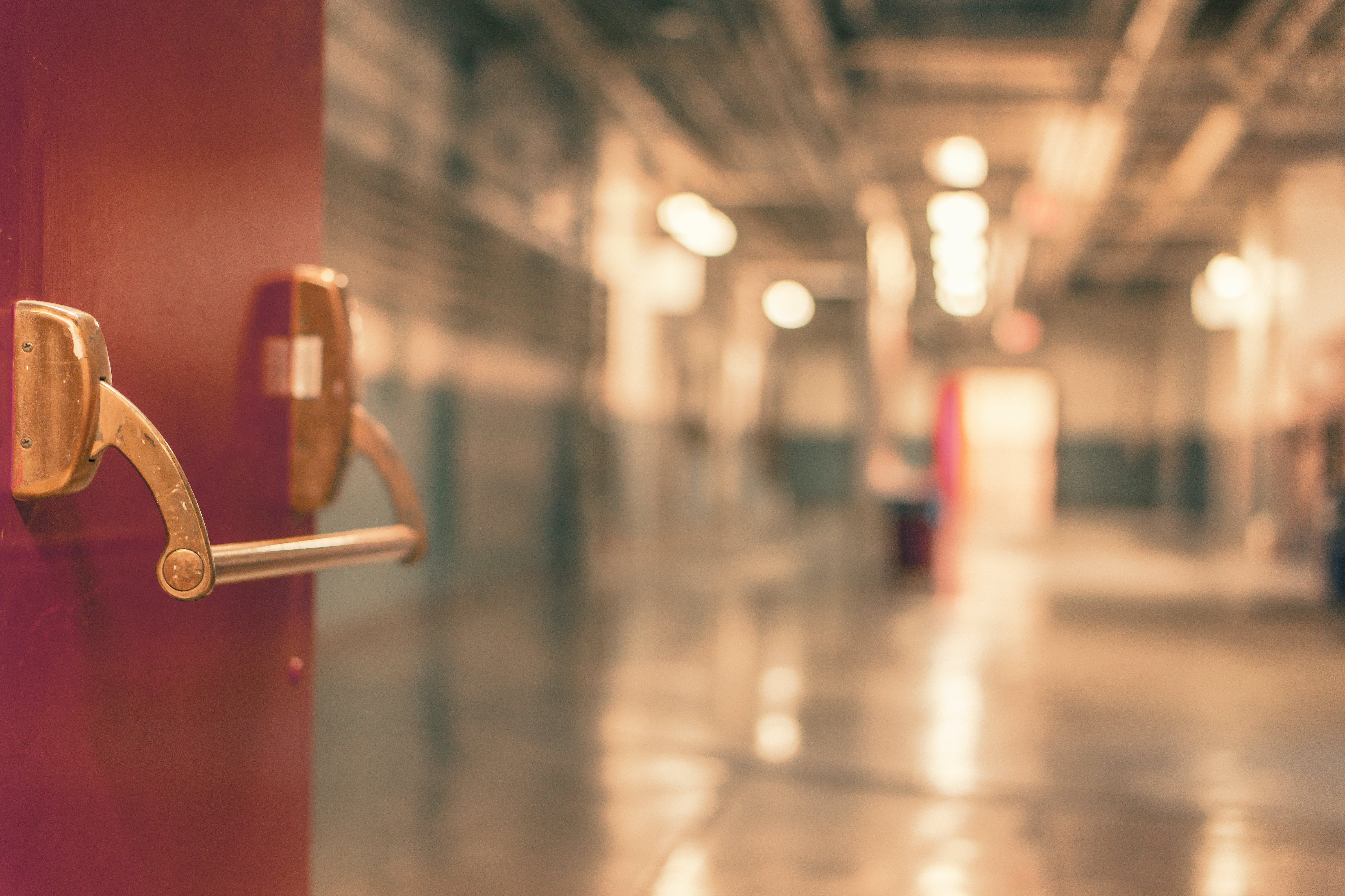 A blurry picture of a generic school hallway with lockers