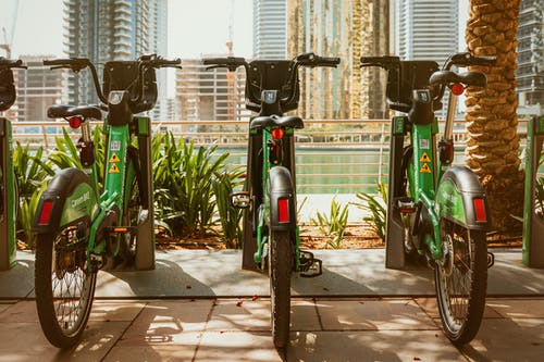 Photo of Green Bicycles Parked on Bike Parking