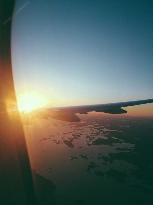 Airplane Window View of Sunrise