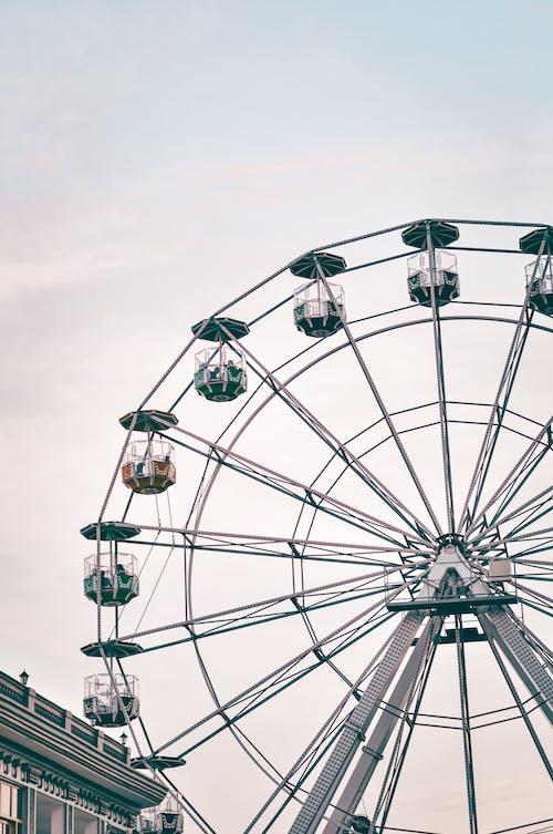 White Ferris Wheel Under Gray Sky