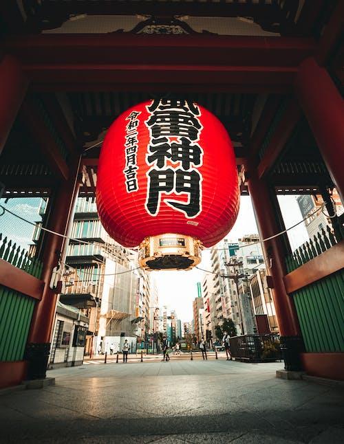 Traditional Asian lantern hanging inside gate of old shrine
