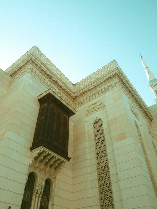 Ornamental building on traditional mosque on sunny day