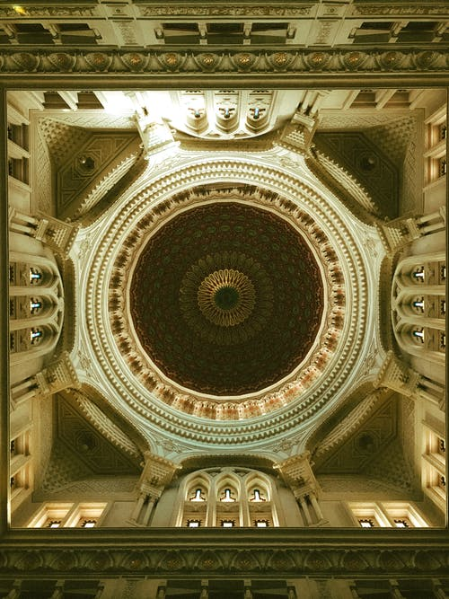 From below of painted and richly decorated dome inside Emir Abdelkader Mosque located in Algeria