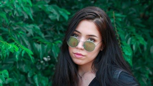 Photo of Woman Wearing Sunglasses
