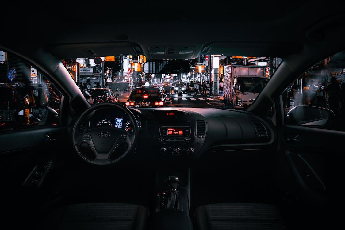 Black Car Steering Wheel during Night Time