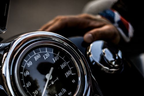 Close-Up Photo of Motorcycle Speedometer