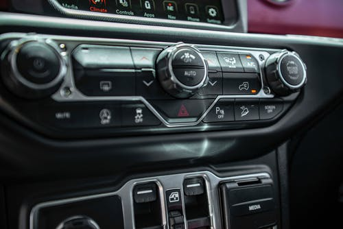 Buttons on control panel inside vehicle