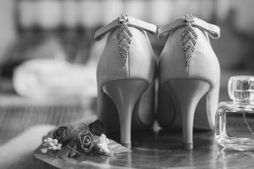 Grayscale Photo of Pair of Open Toe Pumps