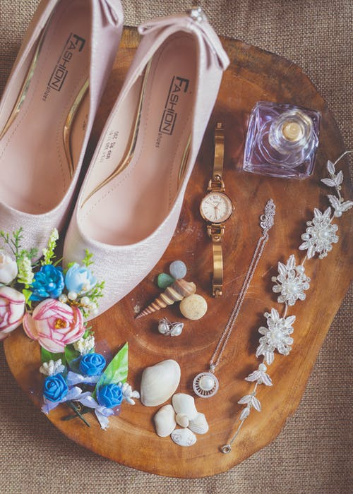 Set of precious accessories and shoes composed with decorative elements