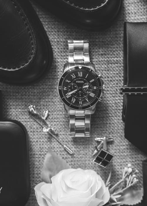 Monochrome Photo of Round Analog Watch