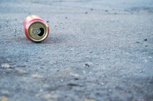 Photo of Empty Soda Can on Concrete Floor