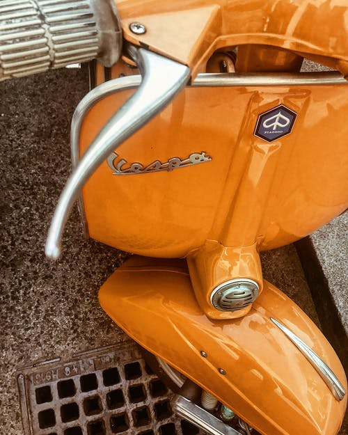Close-Up Photo of Orange Vespa