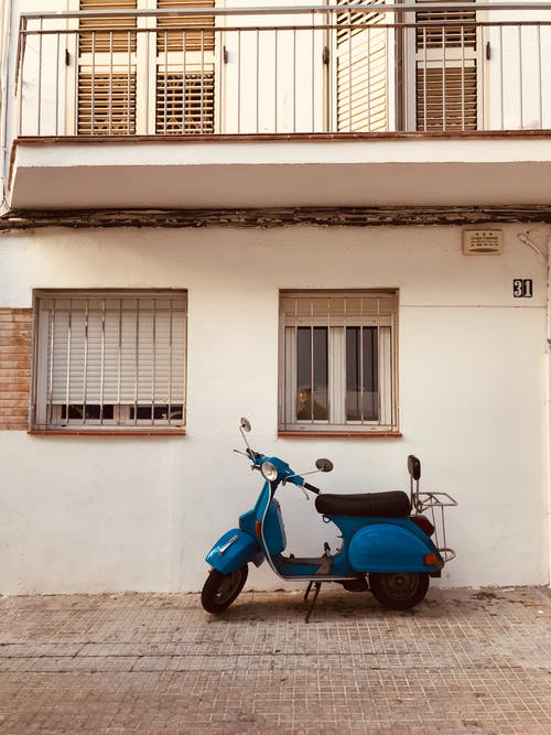 Retro scooter parked near old building