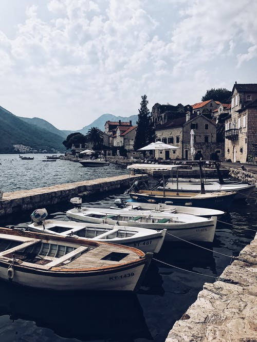 Old boats on bay shore in ancient town