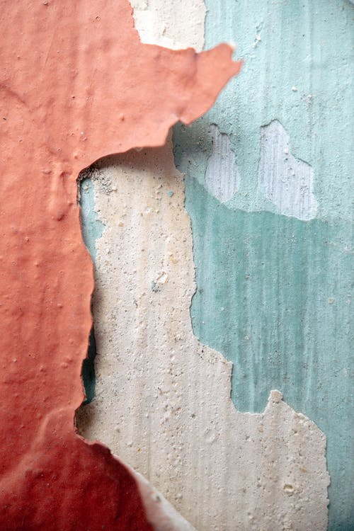 Textured weathered wall with colorful dye