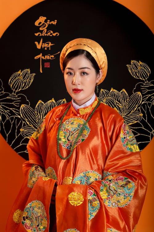 Woman in traditional orange kimono